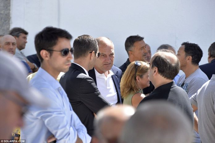 Manchester United first-team coach Silvino Louro (centre) was also on hand to support Mourinho at the funeral