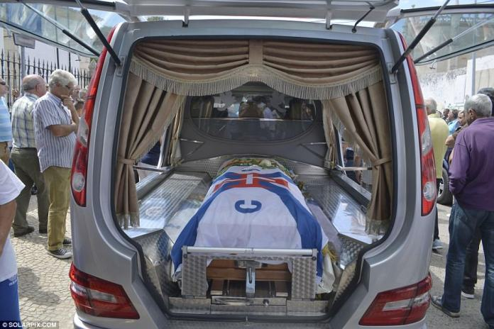 Mourinho Felix's coffin is draped in a white flag before being taken to the church on Tuesday