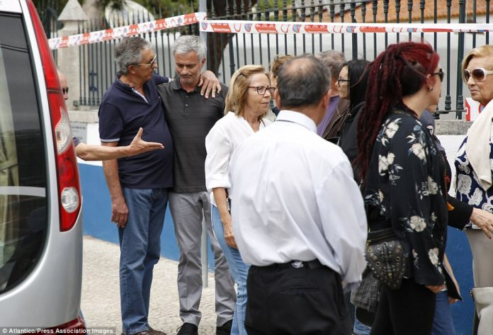 Mourinho was comforted by a friend after arriving back in Portugal ahead of his father's funeral