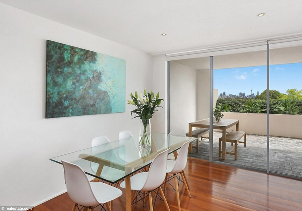 Open-plan living: A spacious dining area leads out onto the balcony, offering an additional entertaining area for guests