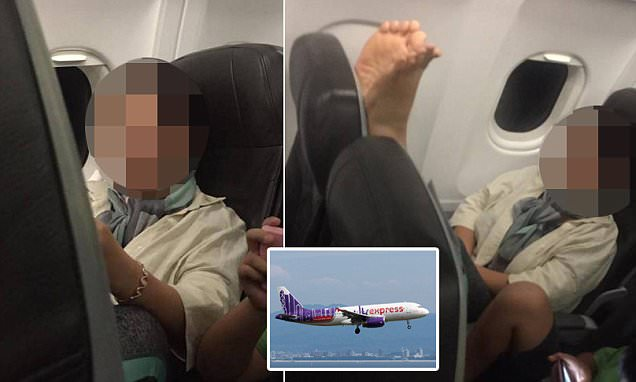 HK Express passenger puts bare feet on back of her seat