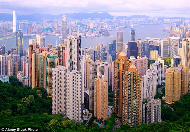 High life: The soaring skyscrapers of Hong Kong Island are surrounded by lush greenery