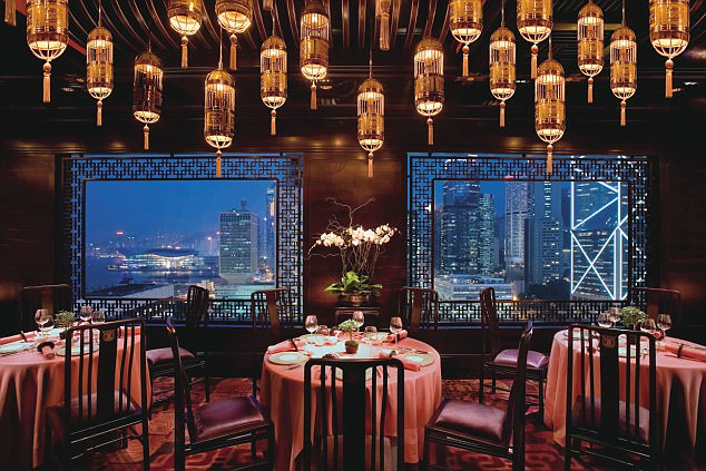Opulent: Take in the twinkling skyline from the Mandarin Oriental's Man Wah restaurant