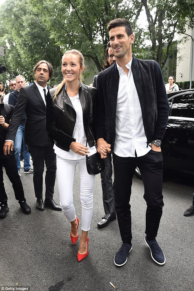 Novak  and Jelena arrive at the Giorgio Armani show during Milan Fashion Week