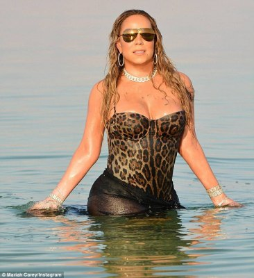 Vision of leopard: Mariah Carey posted this extravagant snap in Israel's Dead Sea on Thursday