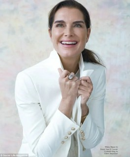 Radiant: The actress looks stunning in a white coat as she shows off her timeless good looks