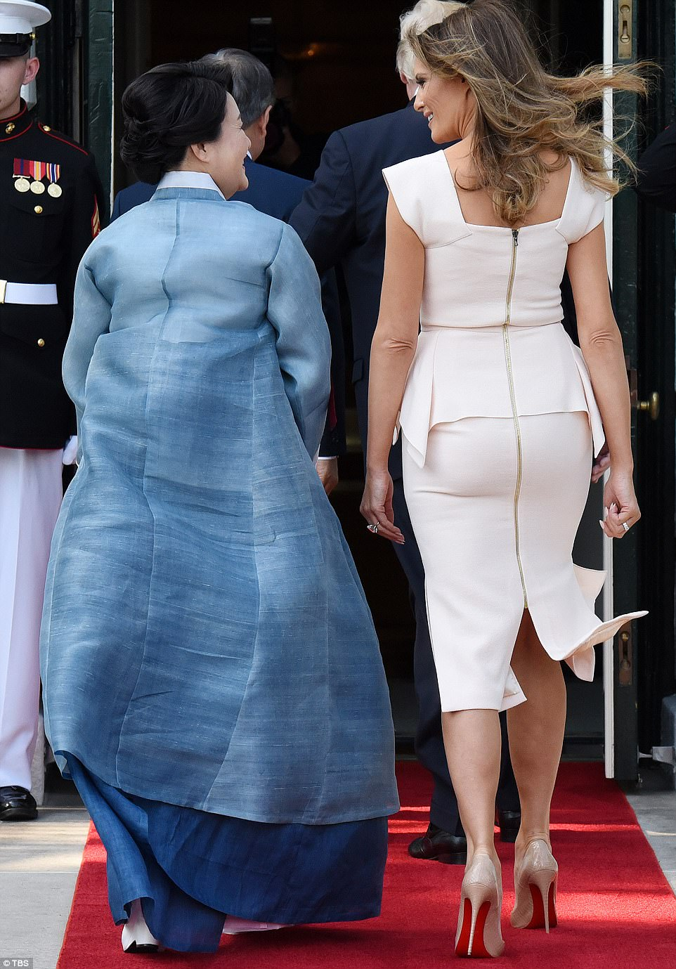 Melania teamed her fitted cocktail dress with a pair of nude patent Christian Louboutin heels
