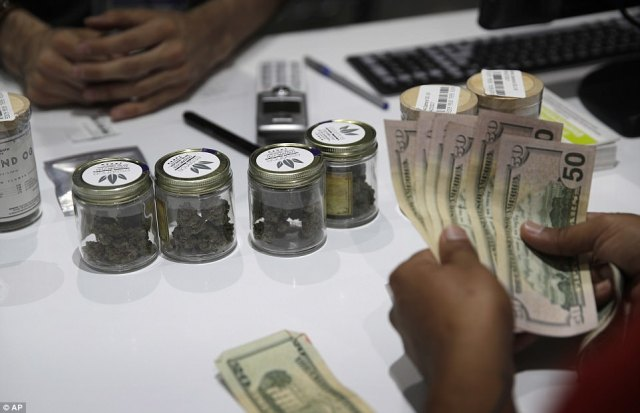 A person buys marijuana at the Essence dispensary. Las Vegas is expected to reap a huge tax windfall of up to $60million for the first two years of legalized sales