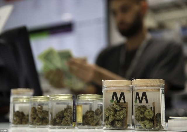 A cashier rings up a marijuana sale as Nevada becomes the fifth state to legally sell weed for recreational purposes