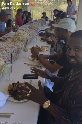 Lavish lunch:Kanye looked happy as can be as he enjoyed the delicious lunch party thrown by his wife in Calabasas on Sunday