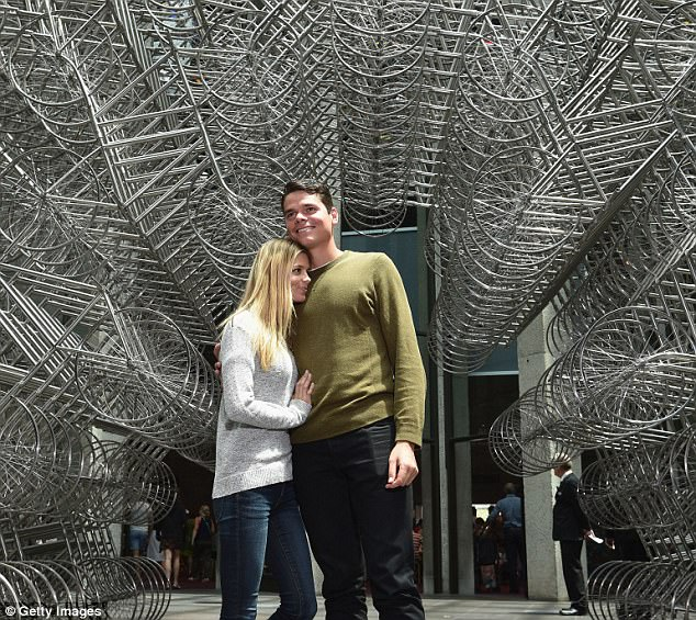 Milos Raonicposes with girlfriend Danielle Knudson in front of Ai Weiwei Forever Bicycles exhibition at The National Gallery Victoria