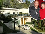 Pictured is Melanie B's house in the Hollywood Hills, Los Angeles that is estimated at $3 million. The former 'Spice Girl', also known as 'Scary Spice', has just had a rooftop completed with lounge chairs and umbrellas, with her white Mercedes sports car parked outside. <P> Pictured: Melanie Brown's House, Hollywood Hills, Los Angeles <P> <B>Ref: SPL167512  260310  </B><BR/> Picture by: Splash News<BR/> </P><P> <B>Splash News and Pictures</B><BR/> Los Angeles:	310-821-2666<BR/> New York:	212-619-2666<BR/> London:	870-934-2666<BR/> photodesk@splashnews.com<BR/> </P>