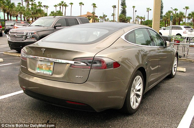 In addition to upgrading their SUV, the couple bought a  gold $90,000 Tesla Model S