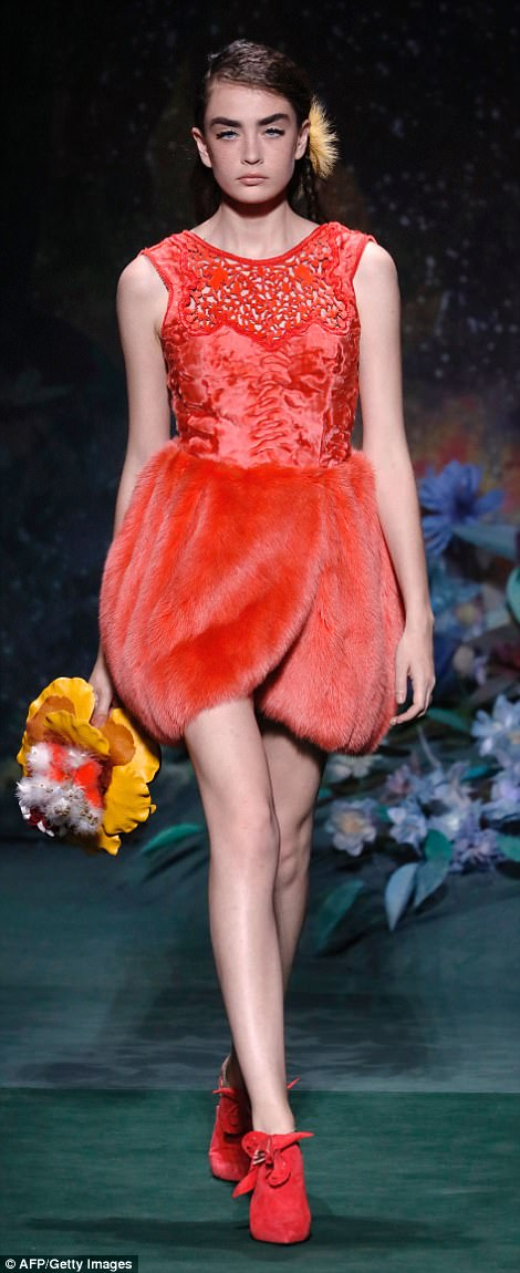 Red hot: Karl mixed and matched textures, pairing faux fur, lace and silk in his intricate designs