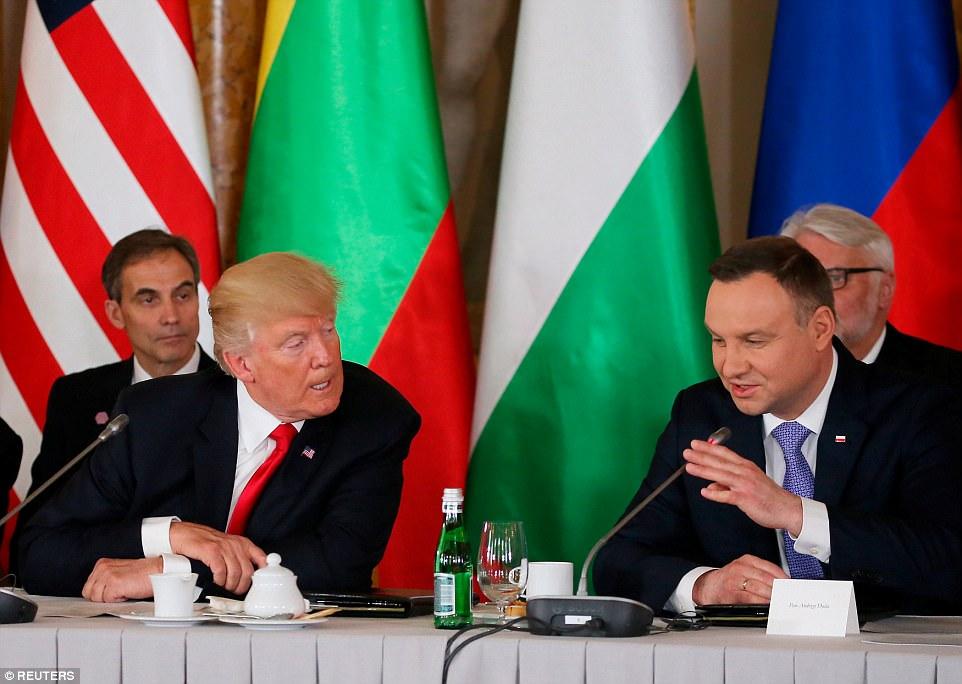 Trump talks to Duda as US ambassador to Poland Paul W Jones looks on during the Three Seas Initiative Summit on Thursday