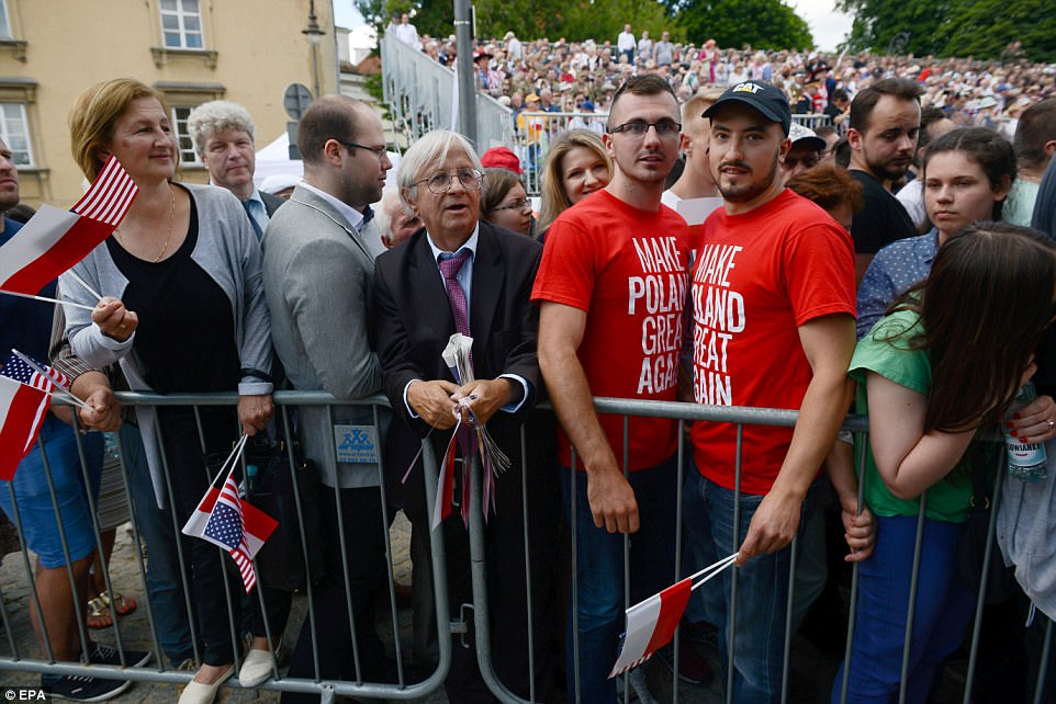 Some supporters in the crowd made T-shirts reading 'Make Poland Great Again' a phrase that played on Trump's 'MAGA' campaign slogan