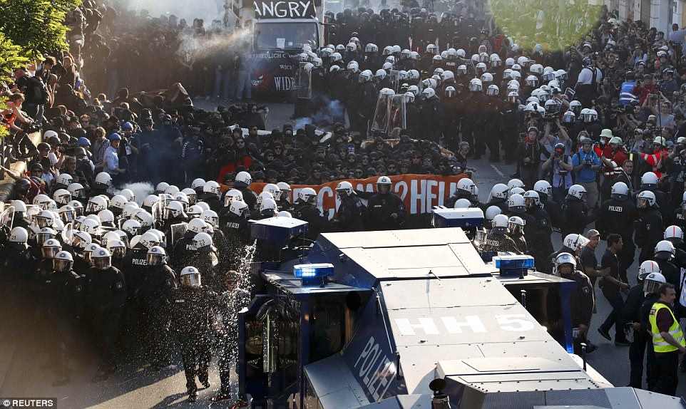 Pictured: A group of protesters is broken off from the main demonstration and surrounded by German riot police in Hamburg