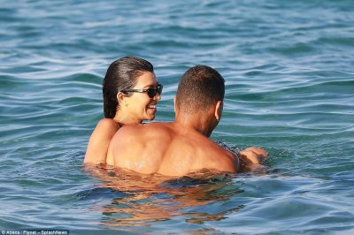 Toyboy fun: The two cuddled up as they splashed around together earlier in the day