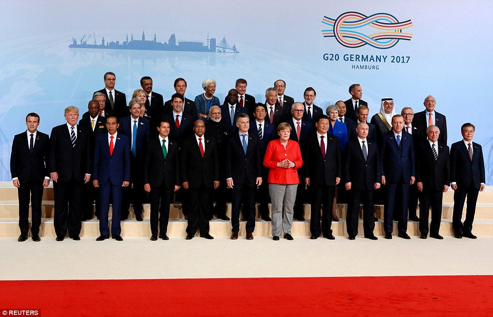 Trump (second from left in the front row) and Putin (fourth from right in the front row) stood far from another in a group shot of the leaders involved in the G20 summit