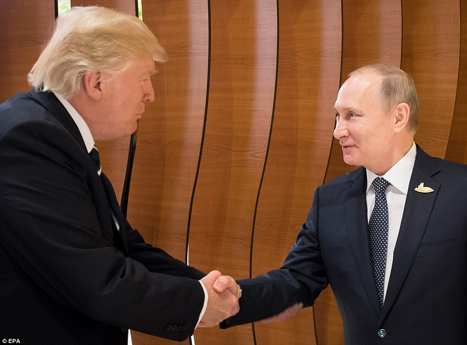 In video of the meeting, Trump is seen shaking Vlad's hand rightie-to-rightie, and using his left hand to pat the underside of Putin's arm