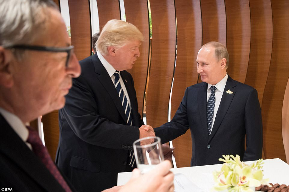 President Donald Trump and Russian President Vladimir Putin gave one another a warm welcome on Thursday as they shook hands during their introduction at the G20 Summit in Hamburg, Germany