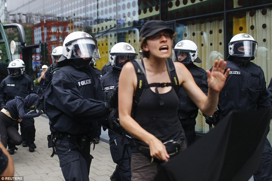 Police push away activists who tried to block a street during the G20 summit in Hamburg on Friday, an event gathering leaders from around the world