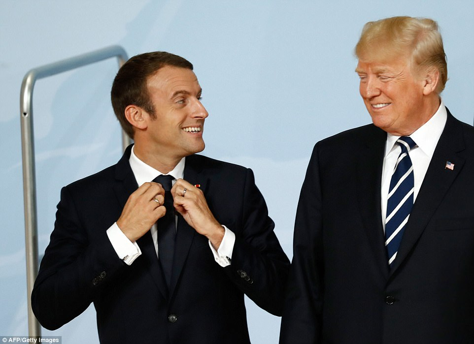 Macron and Trump laughed as they stood next to one another during a posed group photo of all of the world leaders at the G20 Summit