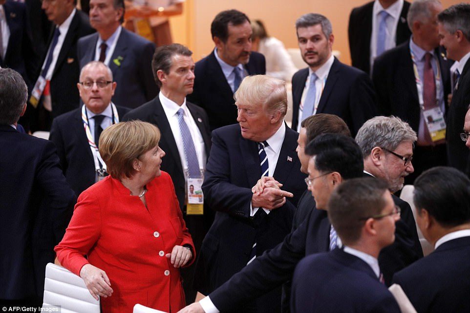 Merkel, Trump and Macron talk before getting down to business at the start of the first working session of the G20 meeting
