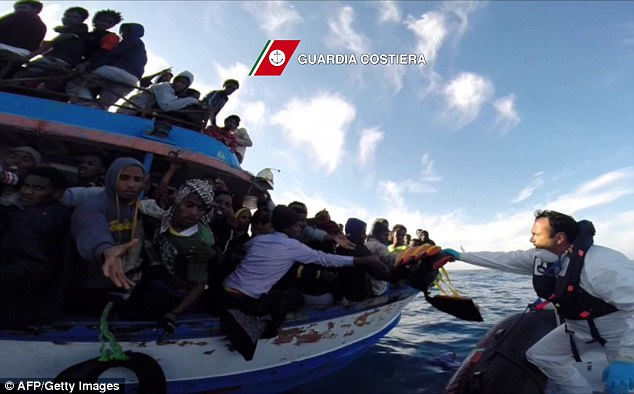 Italy wanted its neighbours to open their ports to rescue ships so the number of migrants would be spread out across more countries on the Continent. Pictured: Migrants rescued by the Italian coastguard