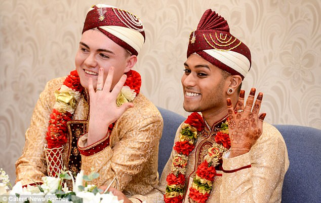 The happy couple, pictured, met two years ago when Mr Choudhury, right, was considering ending his life when he was approached by Mr Rogan, left, who spoke to him on a bench