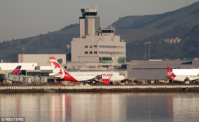 Near miss: San Francisco International Airport (pictured) avoided a cataclysmic disaster Friday when an Air Canada plane containing up to 220 people nearly landed on four other jumbo jets