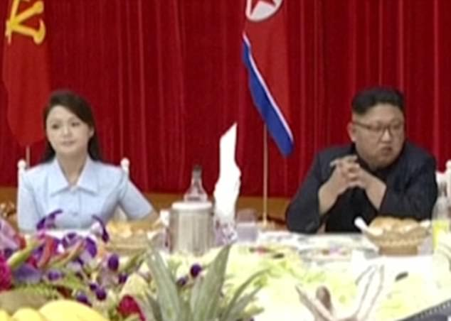 Kim Jong-un's wife Ri Sol-ju (left) has been seen in public for the first time in four months shutting down speculation she had fallen out with the North Korean dictator (right)