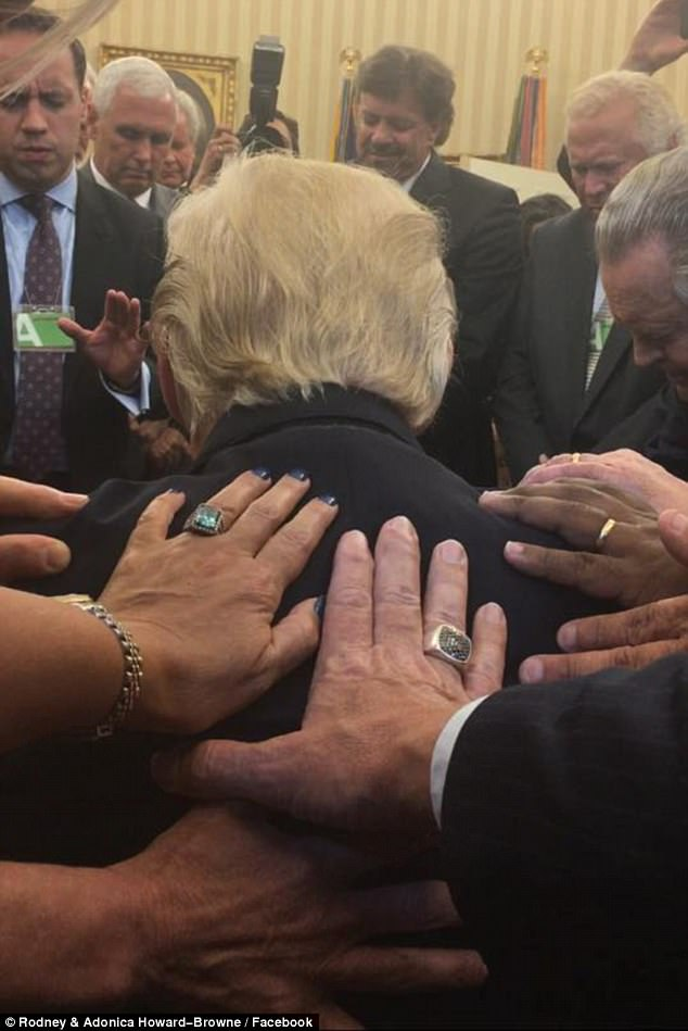 Evangelical pastor Rodney Howard-Browne posted this image of himself and wife Adonica leading prayers over President Trump on Monday as people laid their hands on him