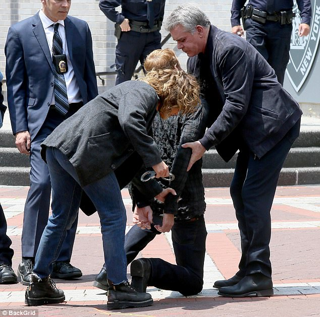 Jennifer Lopez handcuffs a criminal on Shades Of Blue set