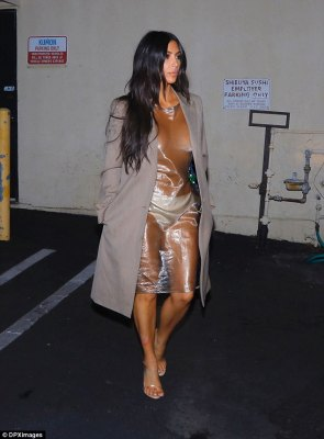Showing off her hot property: Kim Kardashian flashed the flesh in this sheer vintage Helmut Lang dress when going out to sushi in Calabasas, California on Thursday evening