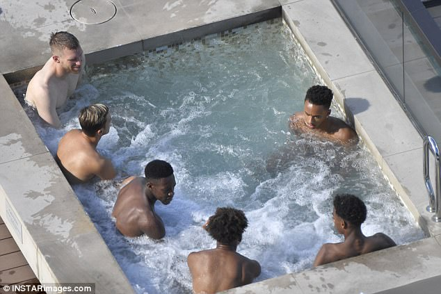 Arsenal stars have been unwinding in the pool following their opening victory in Sydney