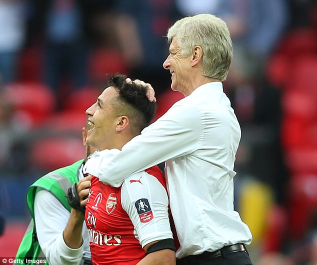 Wenger and Sanchez celebrating together after Arsenal's FA Cup success at Wembley in May