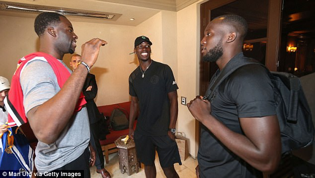 Green talks with United's new signing Lukaku in Los Angeles as Pogba looks on
