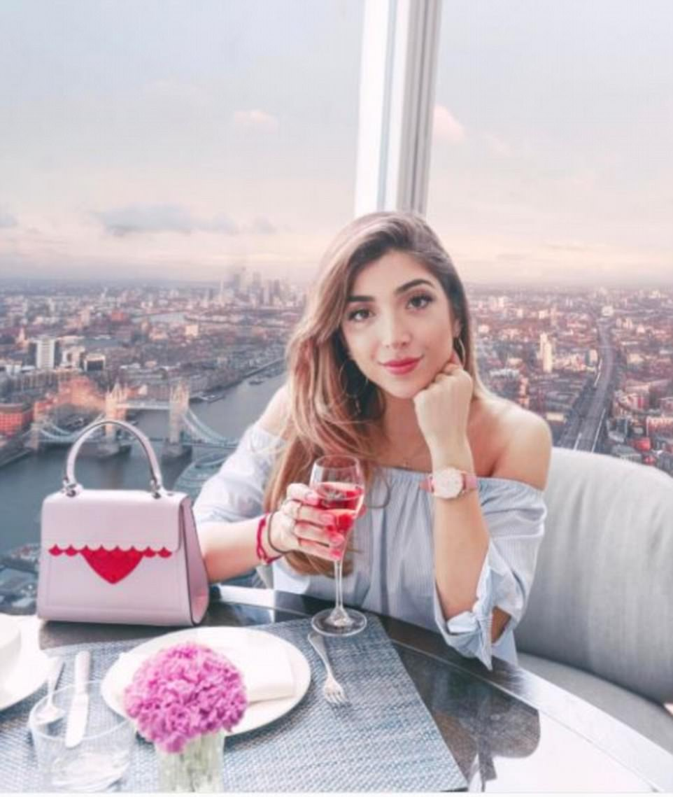 Drawing followers' attention to the watch she is wearing in a shot taken in The Shard, London, the blogger wrote: 'When the pink sunset vibes seem to be rubbing off on everything around you wearing @henrywatches #henrylondon #ourtime'