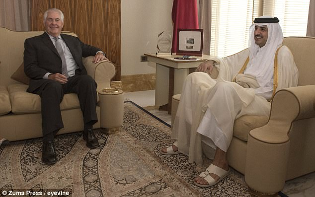 US officials claim the UAE is behind the hacking of Qatar's news agency in May which sparked a diplomatic crisis. Secretary of State Rex Tillerson was in Doha last week to try to resolve the crisis with Qatar's Sheikh Tamim Bin Hamad Al Thani (above together on July 11)