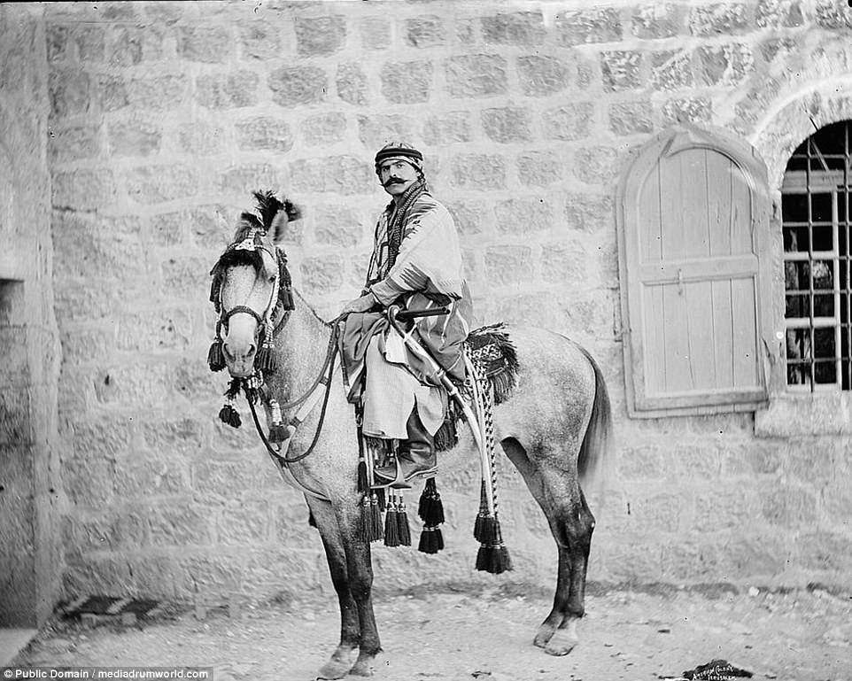 Fascinating black and white photos have emerged revealing the lives of nomadic Arab Bedouins around the turn of the twentieth century. One image shows a Bedouin  in traditional clothes riding a horse at an American colony in Jerusalem, sometime between 1898 and 1914