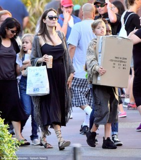 Too cute:Little Vivienne seemed to be holding the product of their visit to the popular stuffed animal store, as she clutched a teddy bear to her chest