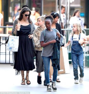 Nice kicks AJ:The mother-of-six opted for a bit of bohemian style for the shopping spree, donning black gladiator sandals