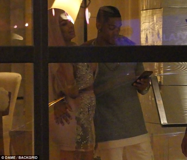 Multi-tasker: He had his hand on her backside as he checked his phone