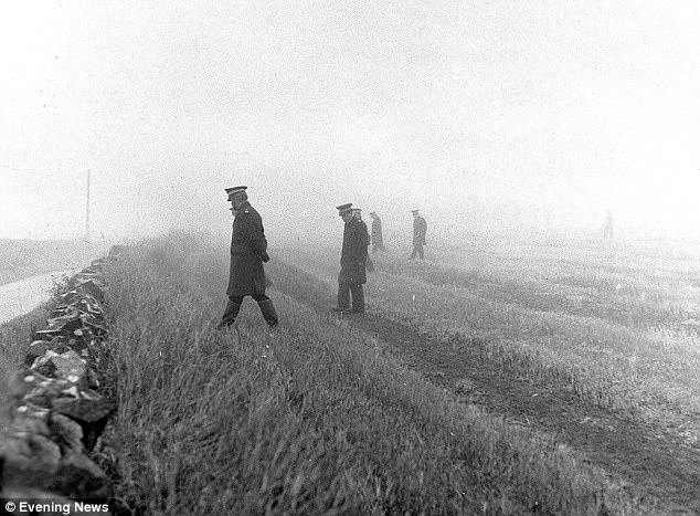 Police search the fields in the mist near the spot where Miss Eadie was found on October 16 1977