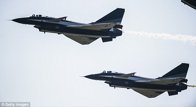 Two Chinese J-10 fighter jets (seen in file image) buzzed an American surveillance plane over the East China Sea over the weekend, almost causing a collision, US officials said