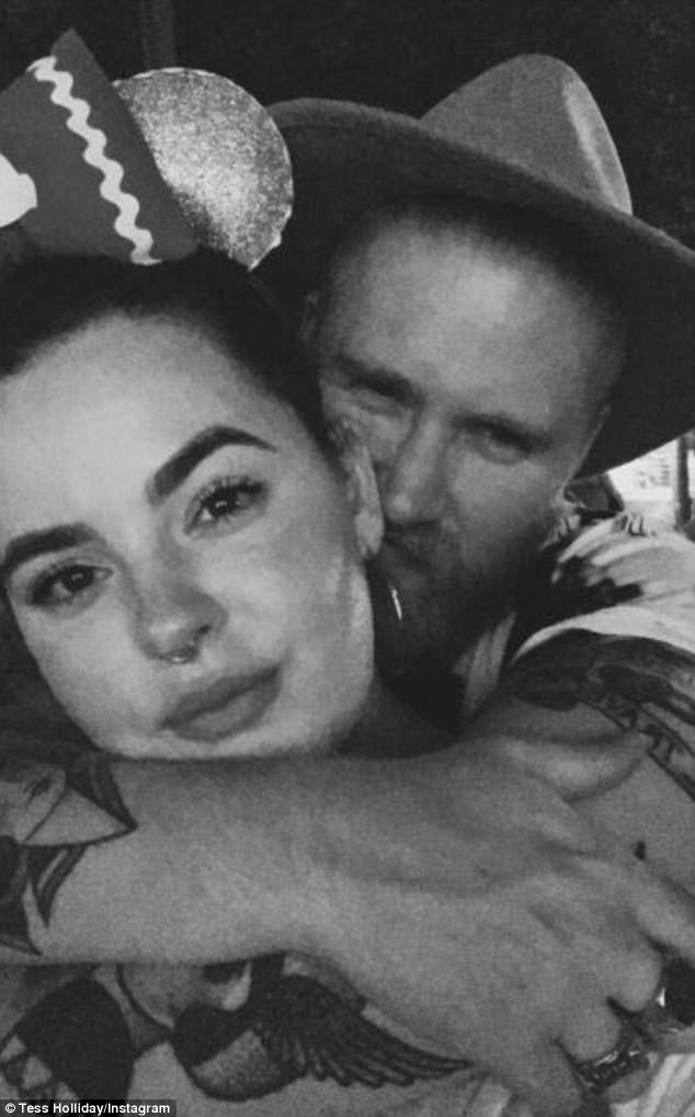 Look of love: Tess took to Instagram on Wednesday to share a sweet black and white photo of her and her husband Nick, while paying tribute to her partner