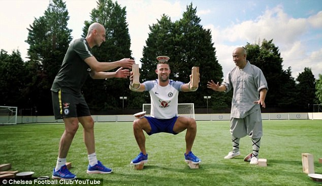 Centre back Cahill was watched over by goalkeeper Willy Caballero and a Shaolin monk