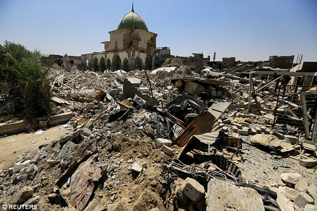 The devastation of Mosul is laid bare outside the ruined Grand al-Nuri Mosque in the Old City