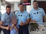 Police officers give thumbs up with the British boy, whose face has been obscured for privacy reasons
